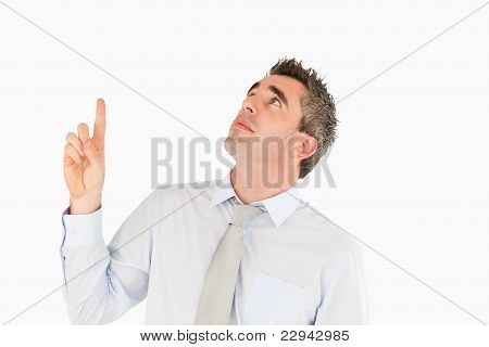 Business Manager Pointing At A Copy Space