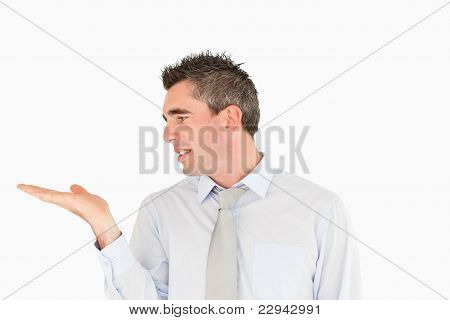 Smiling Businessman Looking At A Copy Space