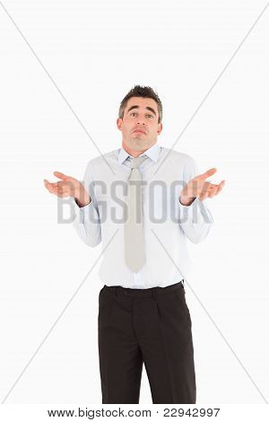 Portrait Of A Clueless Businessman Posing