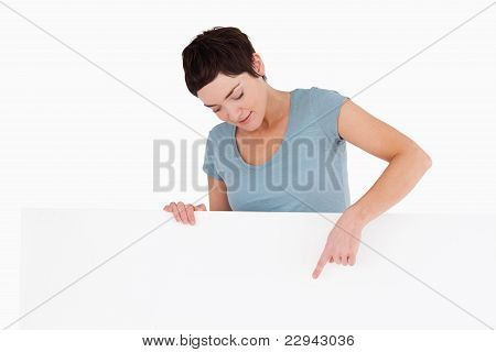 Woman Pointing At Copy Space On A Panel