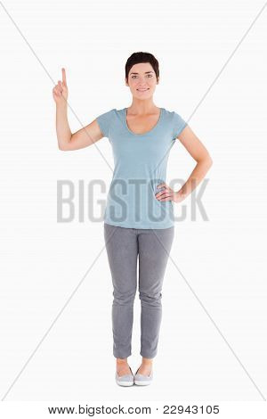Good Looking Woman Pointing At Blank Space