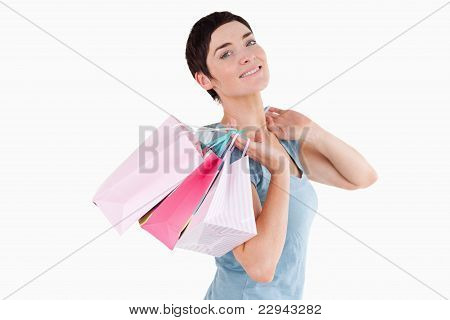 Dark-haired Woman Posing With Shopping Bags