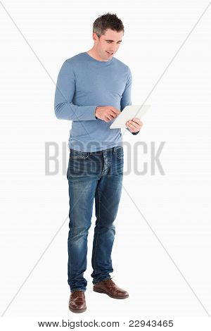 Handsome Man Using A Tablet Computer