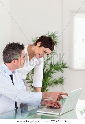 Portrait Of A Man Pointing At Something To His Colleague On A La