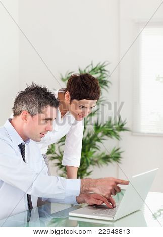 Portrait Of A Man Pointing At Something To His Colleague On A No