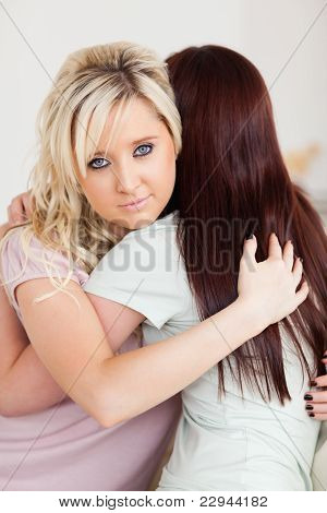 Depressed Young Women Hugging On A Sofa