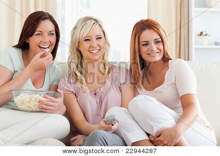 Joyful Women Watching A Movie Eating Popcorn