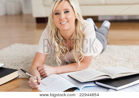 Blond Charming College Student Lying On The Floor Learning