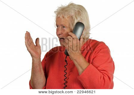 Senior Woman Is Discussing While Telephoning