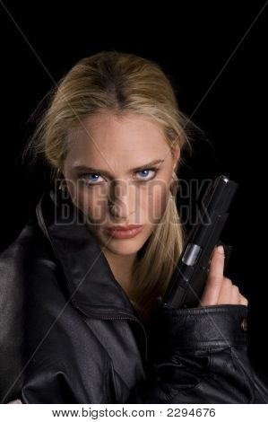 Steely Eyed Woman Woth Gun