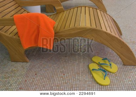 Sunbed With Towel  And Yellow Sandals Near Closeup
