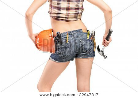 Back view of a female worker holding a hammer and helmet isolated on white background