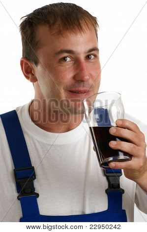 Craftsmen In Blue Overall Holding A Soft Drink