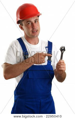Craftsmen In Work Clothes Holding An Adjustable Wrench