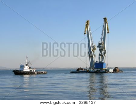 Large Maritime Cranes Towed By Boat