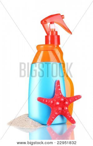 sunblock in bottles and starfish isolated on white