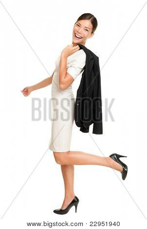 Walking business woman smiling happy  isolated on white background in full length holding her jacket casual over the shoulder. Mixed race Caucasian Asian businesswoman.