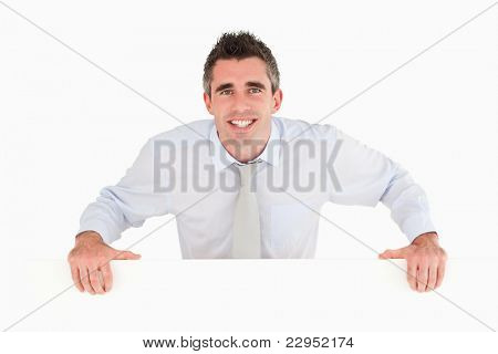 Businessman standing behind a copy space against a white background