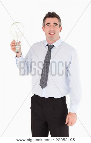 Man holding a light bulb against a white background