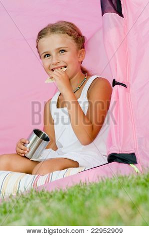 Camping in tent -  happy girl on camp tent