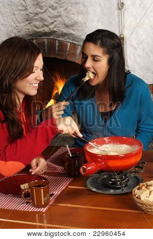 Women Eating Fondue
