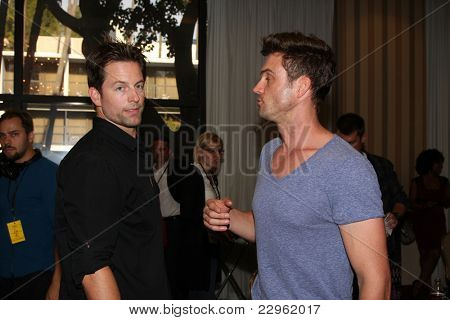 LOS ANGELES - AUG 26:  Michael Muhney, Daniel Goddard attending the Young & Restless Fan Dinner 2011 at the Universal Sheraton Hotel on August 26, 2011 in Los Angeles, CA