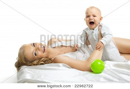 Pretty woman smile and small baby cry