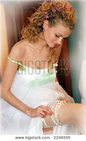 Bride Pulling On Her Garter