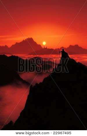 A fantasy image with a man watching to the far city and the sunset in red