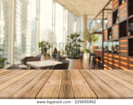 poster of Wooden Board Empty Table Top On Of Blurred Background. Perspective Brown Wood Table Over Blur In Cof