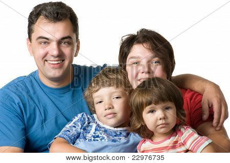 Casual Portrait Of A Young Family On White