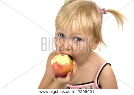 Little Blond Girl Eating Red Apple