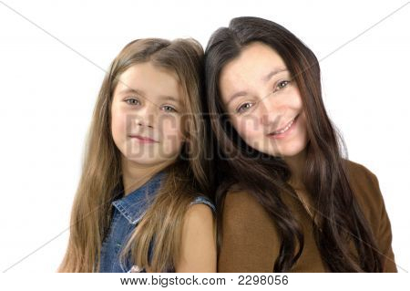 Mother And Daughter Sitting Close Together