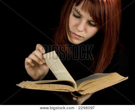 Girl Turning Book Pages