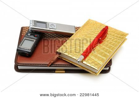 Dictaphone notepad and ballpen isolated on white background