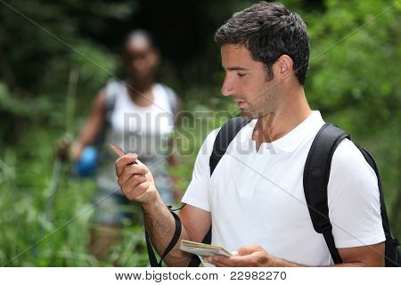 Couple in woods orienteering