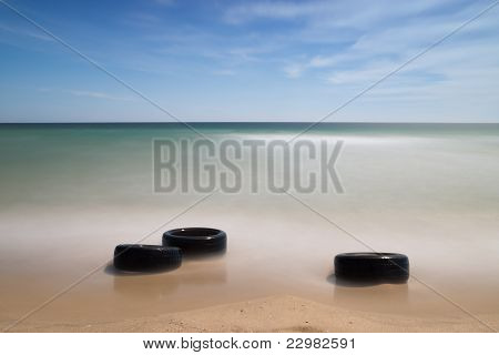 Discarded old tyres on beach