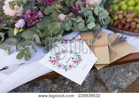 poster of Wedding Invitations In The Craft Envelopes With A Bunches Of Lavender. Wedding Concept. Wedding Acce