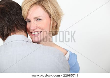 Smiling woman embracing her partner