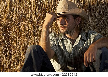 Cowboy Sitting on the Ground