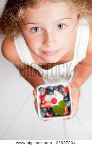 Healthy Food - Cute girl with fresh berries