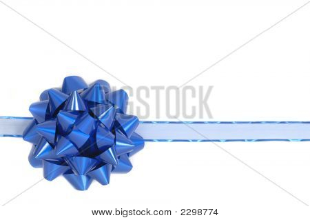 Blue Christmas Bow And Ribbon Showing A Wrapped Package