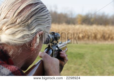 Hunter aiming his gun