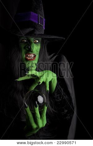 Scary witch with her crystal ball