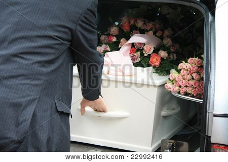 White Coffin In A Grey Hearse