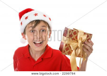 Exuberant Child With Christmas Gift