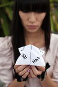 foto of chatterbox  - folded paper word game known as chatterbox cootie catcher fortune teller salt cellar or whirlybird - JPG