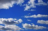 stock photo of clouds sky  - an early autumn blue sky filled with clouds.