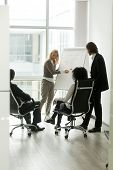 Multi-ethnic Business Partners Discussing New Idea In Boardroom With Flipchart, Businesswoman Coach  poster