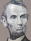 stock photo of abraham  - The portrait of Abraham Lincoln on a gray background from the American Five Dollar Bill - JPG
